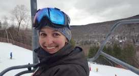 Riding the ski-lift up to ski Loon Mountain.