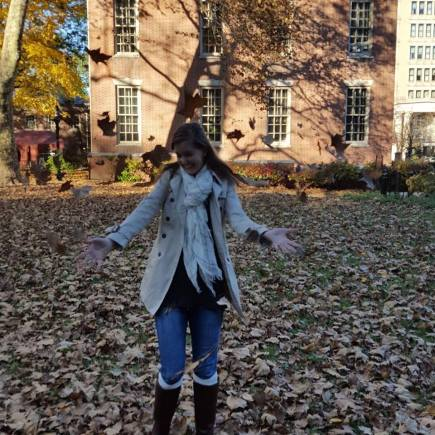 Playing in the autumn leaves in Philadelphia, PA.